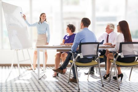 Foto de Cheerful business coach explaining strategy - Imagen libre de derechos