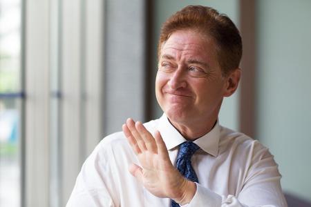 Unpleased mature entrepreneur refusing offer