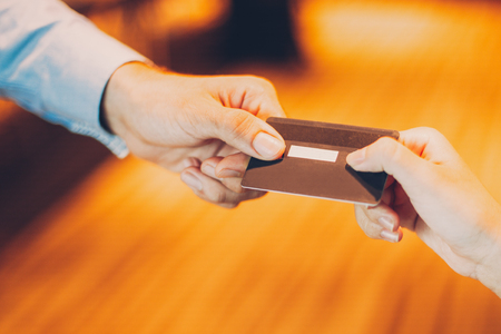 Photo for Man giving credit card to cashier for payment - Royalty Free Image