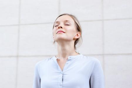 Photo pour Relaxed young woman feeling spiritual energy - image libre de droit