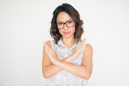 Serious Woman Showing Crossed Hands