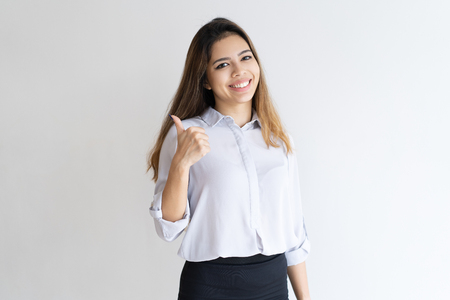 Photo pour Happy customer approving product or service. Beautiful young mix raced woman giving thumb up at camera. Positive feedback concept. - image libre de droit