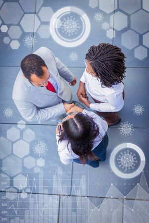 Photo pour Partners near office and virtual pandemic graphics. Top view of business man and women standing outside and shaking hands. Business communication concept - image libre de droit