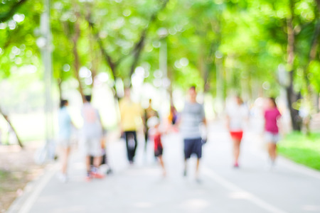 Foto de Blurred background of people activities in park with bokeh, spring and summer season - Imagen libre de derechos