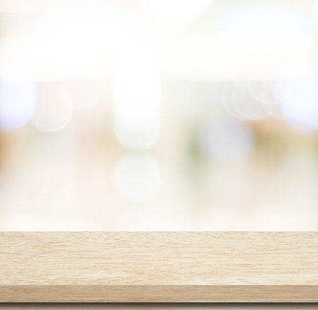 Empty table and blurred store with bokeh background, product display template