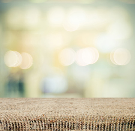 Sackcloth over table and blur bokeh background, templatej product display montage