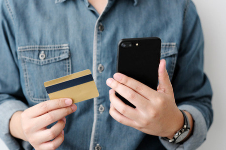 Man hands using smart phone and holding credit card, shopping online concept, mobile banking, business and technology