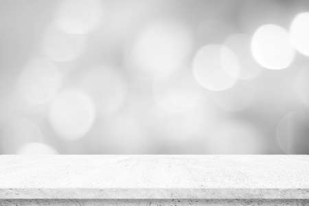 Photo pour Empty white cement table over blur store background, product display montage, black and white tone, monochrome - image libre de droit