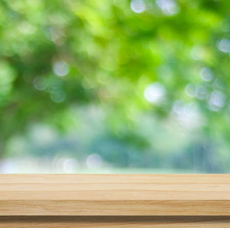 Photo pour Wooden table for food, product display over blur green garden background, Empty wooden shelf, desk and blur tree park with bokeh light in spring, summer, Wood table top, counter and nature background - image libre de droit