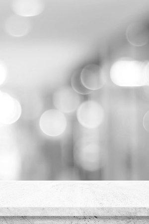 Photo pour Vertical empty white cement table over blur store background, product display montage, black and white tone, monochrome - image libre de droit