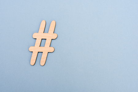 Photo pour Hashtag sign made of wooden material on blue background. Top view - image libre de droit