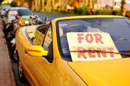 Rent a car sign at street.