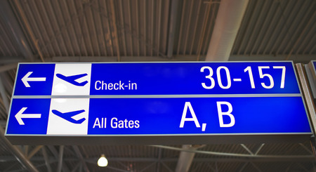 Airport Signs showing the directions to the gates at the Athens International Airport.