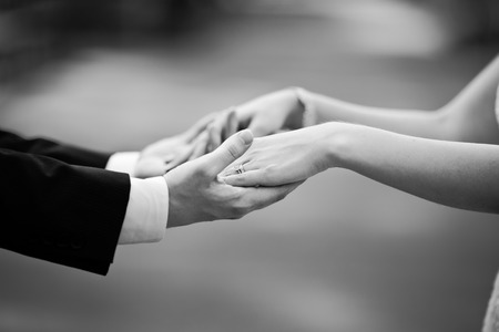 Photo for newly wed couple holding hands, marry me ! - Royalty Free Image