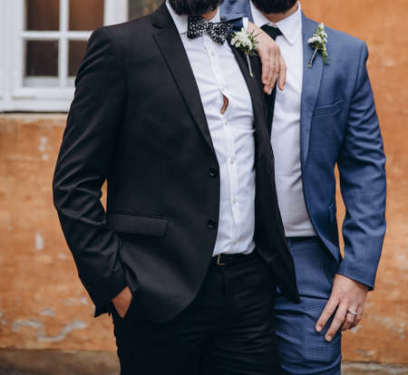 Photo for Newlywed stylish gay couple on their happy wedding day. Equality concept. - Royalty Free Image