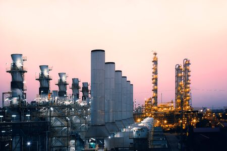 Photo pour Factory of oil and gas refinery industrial plant with sunrise sky background, petrochemical industry, Smoke stacks of power plant - image libre de droit