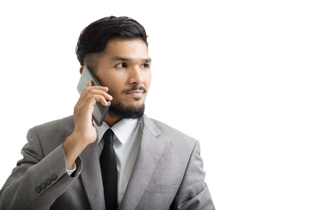 A yong businessman are using smartphone