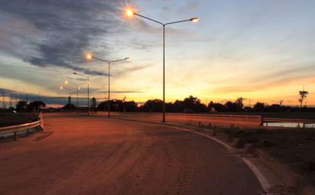 The middle of the road near the back of the sun and sky