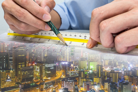 engineer are measuring distance in drawing using pencil and ruler building whole world.