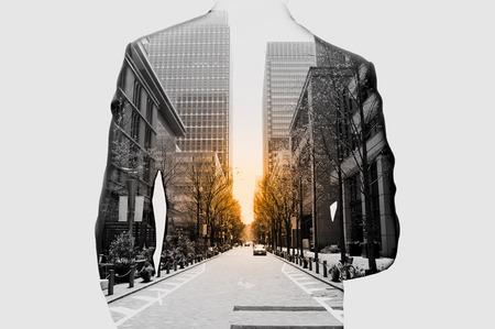 Photo pour Double exposure of businessman in suit and cityscape. He's looking for his success in business and idea for life - image libre de droit