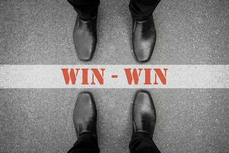 Photo pour Two men standing on both side of the win-win line. Represent that no one has to lose in business, both can win. - image libre de droit