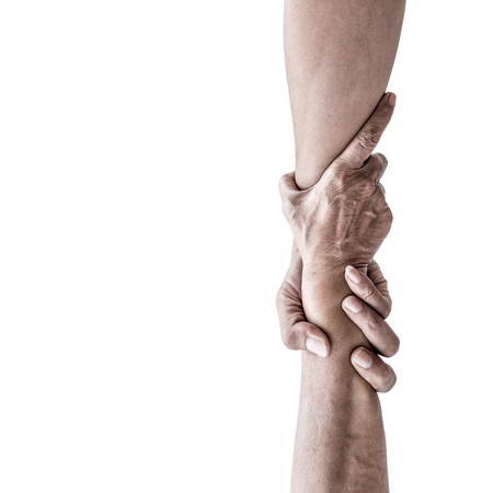 Vertical help hands holding together representing friendship, partnership, help and hope, donation, assistance.