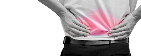 Photo pour Man feeling pain on his back. Office syndrome. Back pain from work. Herniated nucleus pulposus. spine pain. spinal degeneration. - image libre de droit