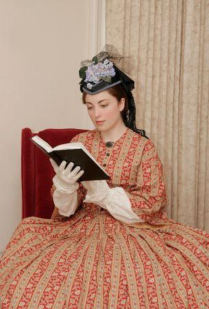reenactor playing young civil war era woman reading a book