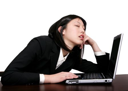 young businesswoman asleep at her computer