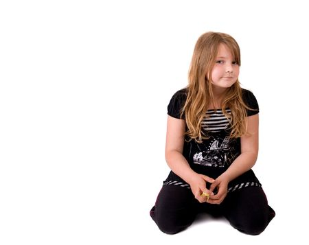 one serious looking young blonde girl kneeling isolated on white