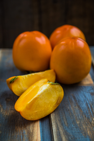 Close up of Ripe Persimmon Fruits, selective focus, shallow DOF