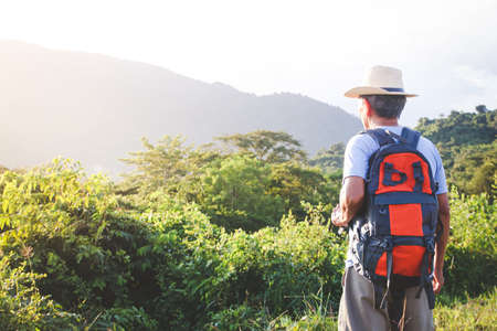 Photo pour Senior man backpacking hiking Nature travel He is healthy. The concept of a happy life after retirement . Copy space - image libre de droit