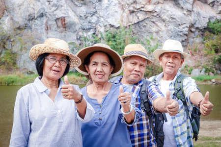 Photo pour Elderly group Trekking the High Mountain Enjoy life after retirement. Elder community concept - image libre de droit