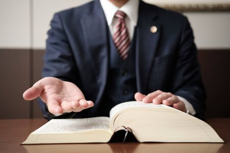 Photo for The Hand of the Lawyer to Reach out for salvation - Royalty Free Image