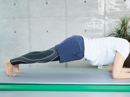 Japanese woman training planck at home