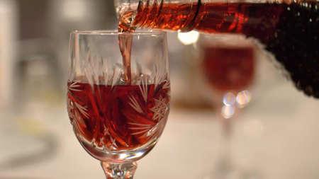 Photo pour Pouring Red Alcohol Liquor Into Shot-Glass Close-Up - image libre de droit