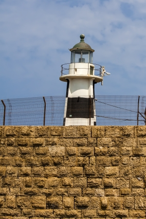 lighthouse on old wall in Akko, Israel