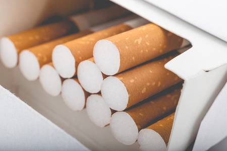 Photo pour Side view of a pack of cigarettes with faded filter - image libre de droit