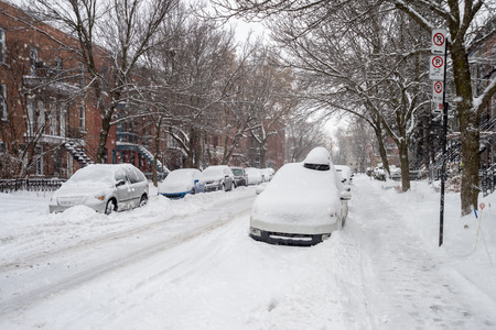 Cars covered in snow during snowstorm in Montreal, December 2016.