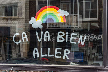 Montreal, CA - 27 April 2020: Ca va bien aller (Its going to be ok) message and rainbow drawing in a window during the Covid 19 pandemy