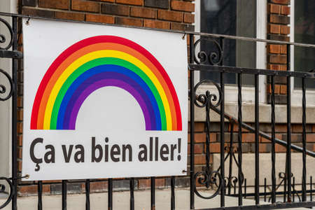 Montreal, CA - 27 April 2020: Ca va bien aller (Its going to be ok) message and rainbow on a balcony during the Covid 19 pandemy