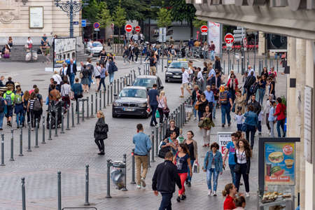 Photo for Lille, France - 15 June 2018: pedestrians walking on Rue des Manneliers street. - Royalty Free Image