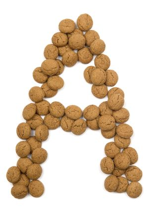Little ginger nuts in the form of the letter A. These little ginger nuts are used in Holland for the Sinterklaas party, which is at Dec 5 every year. Sinterklaas is a sort of Santa Claus. In Holland these ginger nuts are called pepernoot. Isolated on