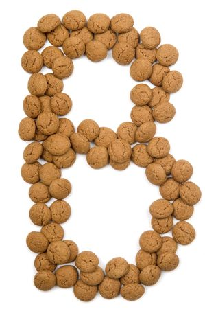 Little ginger nuts in the form of the letter B. These little ginger nuts are used in Holland for the Sinterklaas party, which is at Dec 5 every year. Sinterklaas is a sort of Santa Claus. In Holland these ginger nuts are called pepernoot. Isolated on