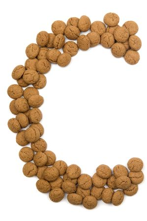 Little ginger nuts in the form of the letter C. These little ginger nuts are used in Holland for the Sinterklaas party, which is at Dec 5 every year. Sinterklaas is a sort of Santa Claus. In Holland these ginger nuts are called pepernoot. Isolated on