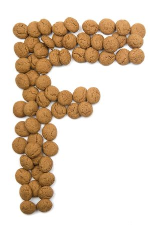 Little ginger nuts in the form of the letter F. These little ginger nuts are used in Holland for the Sinterklaas party, which is at Dec 5 every year. Sinterklaas is a sort of Santa Claus. In Holland these ginger nuts are called pepernoot. Isolated on