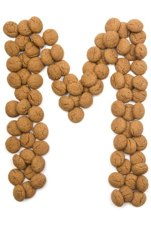 Little ginger nuts in the form of the letter M. These little ginger nuts are used in Holland for the Sinterklaas party, which is at Dec 5 every year. Sinterklaas is a sort of Santa Claus. In Holland these ginger nuts are called pepernoot. Isolated on
