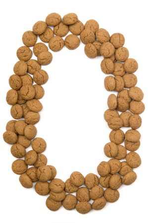 Little ginger nuts in the form of the letter O. These little ginger nuts are used in Holland for the Sinterklaas party, which is at Dec 5 every year. Sinterklaas is a sort of Santa Claus. In Holland these ginger nuts are called pepernoot. Isolated on
