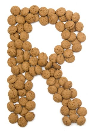 Little ginger nuts in the form of the letter R. These little ginger nuts are used in Holland for the Sinterklaas party, which is at Dec 5 every year. Sinterklaas is a sort of Santa Claus. In Holland these ginger nuts are called pepernoot. Isolated on