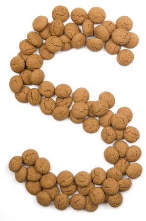 Little ginger nuts in the form of the letter S. These little ginger nuts are used in Holland for the Sinterklaas party, which is at Dec 5 every year. Sinterklaas is a sort of Santa Claus. In Holland these ginger nuts are called pepernoot. Isolated on